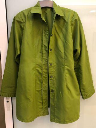 High quality green shirt. Very good material with shoulder padding