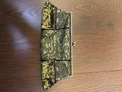 Beaded purse with 2 straps. Brand new. Got it as a gift.