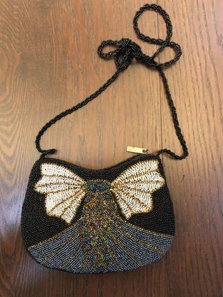 Beaded purse or bag or clutch. Comes with another small purse in it. Never use before. Got it as a gift