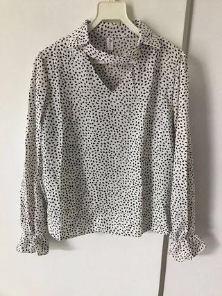 Stylish, comfy printed blouse for work or pair it with casual pants for weekend shopping