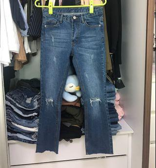 Denim bell jeans with rips