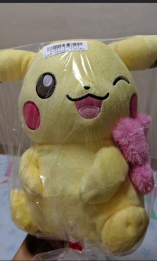 Winking Pikachu with pink scraf