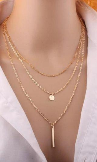 Multi-layered choker long necklace in gold