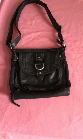 Authentic Fossil leather sling bag.