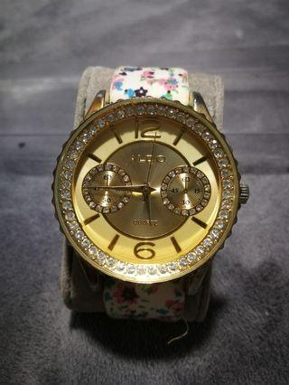 ALDO gold watch with straps
