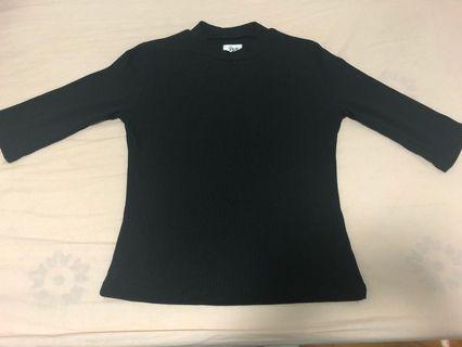 Black tshirt (plain in colour, no pattern)