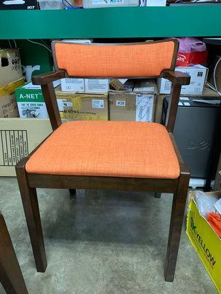 Chair with backrest and orange cushion