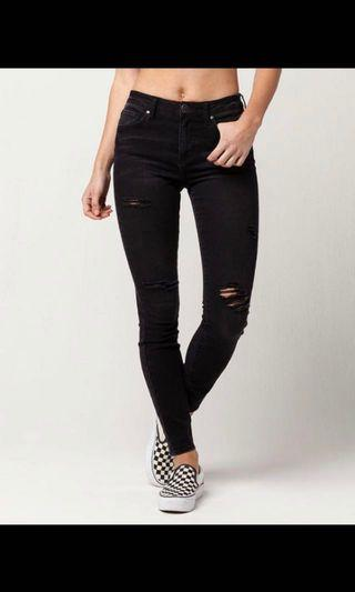Woman's Black Ripped Jeans