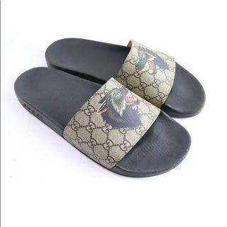 Gucci gg supreme slides with wolf