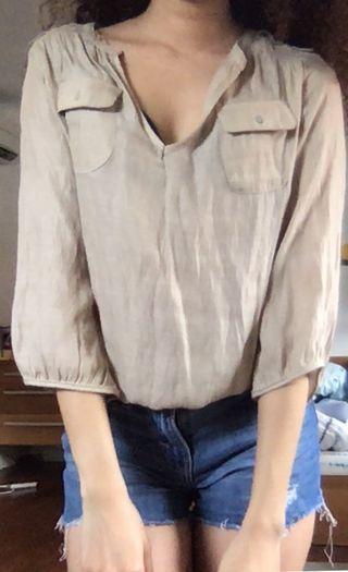 Beige long sleeved top