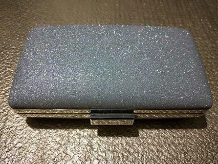 Silver evening clutch bag