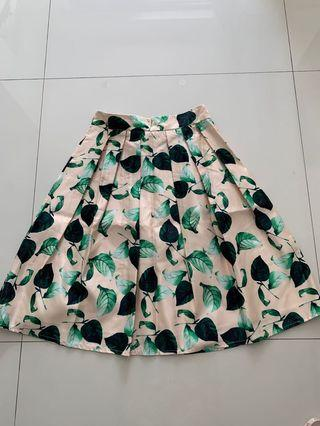 🚚 Floral Skater Skirt - beige background with contrasting green leaves