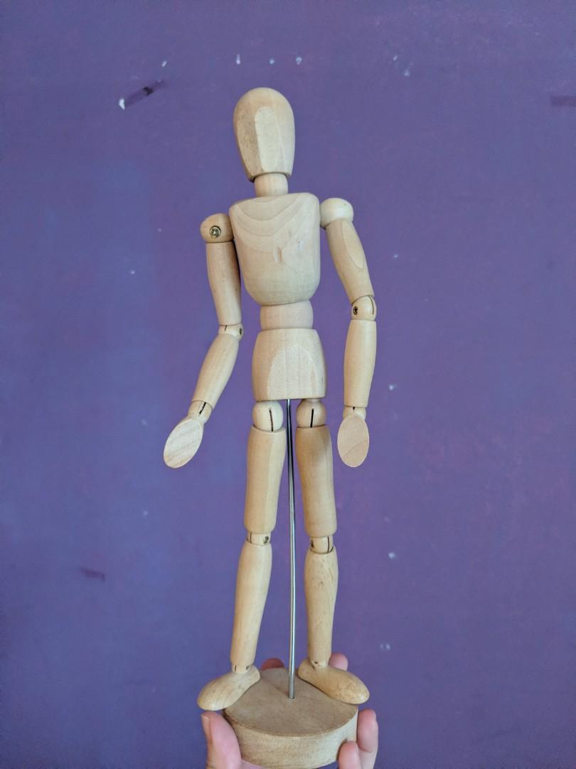 Wooden human figurine