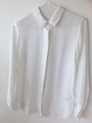 Clean minimalistic white blouse