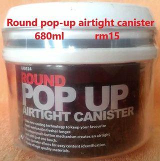 Pop up airtight canister
