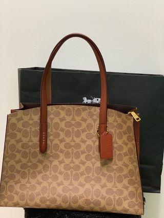Coach Bag ( Charlie Carryall signature in code Rust )