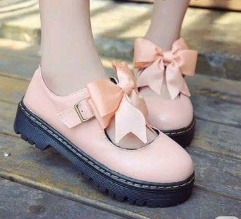 New peach bow shoes