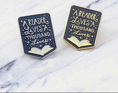 A reader lives a thousand lives Enamel pin