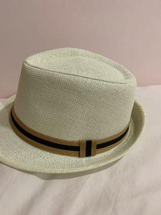 White with brown trimming hat