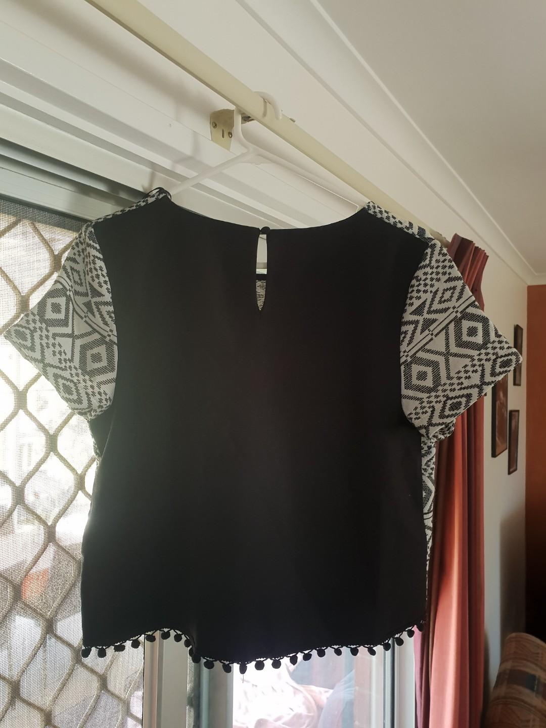 Black and white top with pompom trim detailing. Brand new with tags