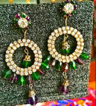 Two pair of earrings with price of 1
