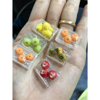 Handmade Miniature fruits on shrink wrapping