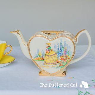 Vintage heart-shaped English ceramic teapot, crinoline lady in her garden