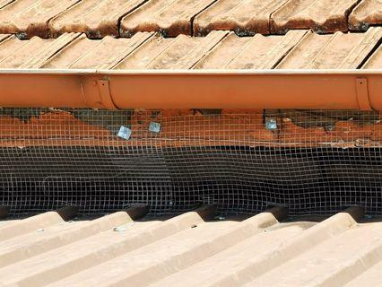 Roofing wire mesh to prevent birds from entering