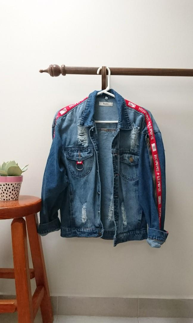 edgy distressed denim jacket with red zip tape stripe