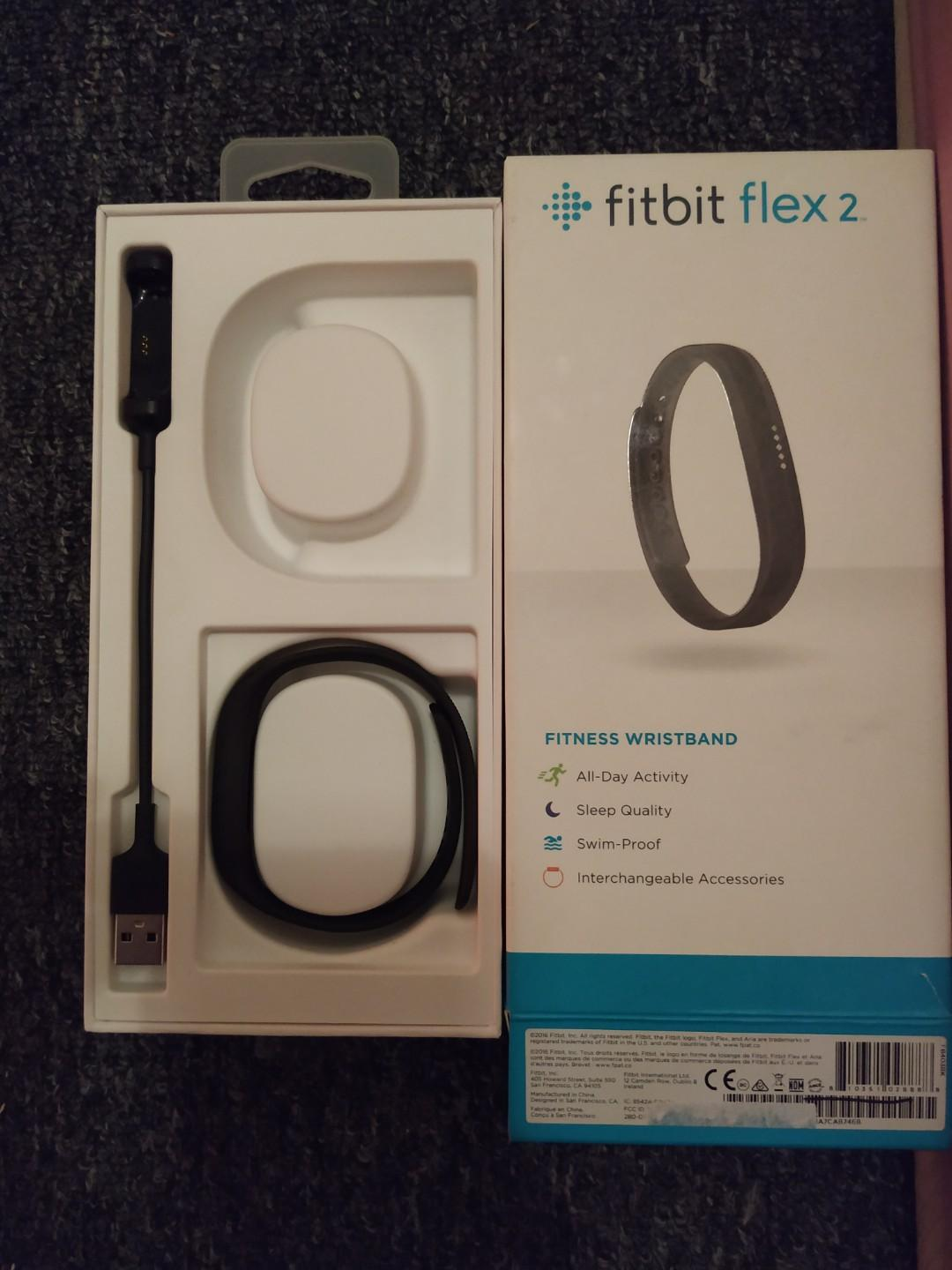 Fitbit flex 2 hardly used with box, charger and two sized bands