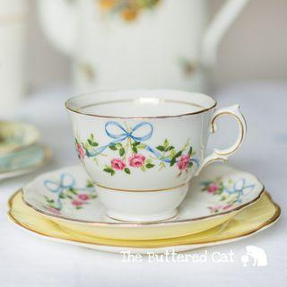 Pretty mismatched / mix and match vintage English china tea trio, blue ribbon bows and pink roses