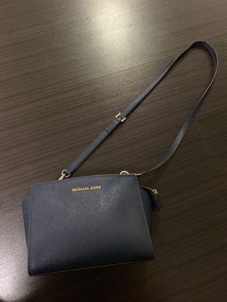 Michael Kors navy sling bag