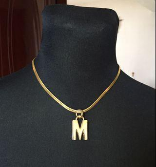 M Gold tone necklace