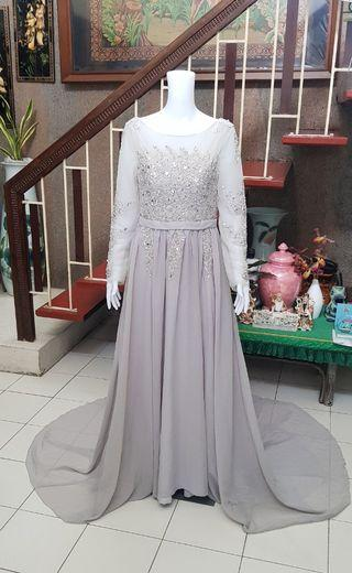 Embellished Gray Sheer Long Sleeve Gown with long trail