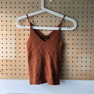 Rust colour knit ribbed v neck top