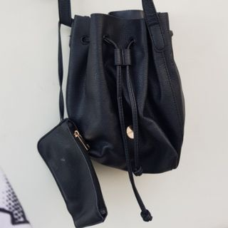 42d08df2d2 BERSHKA Black leather bucket bag with adjustable strap and mini pouch inside