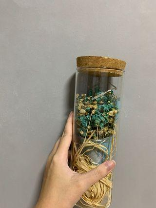 glass bottle w flowers and fairy lights around