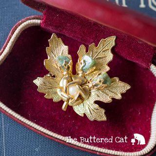 Vintage gold tone + jade stone leaf brooch