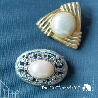 Two vintage cabochon brooches, one silver tone + one gold tone
