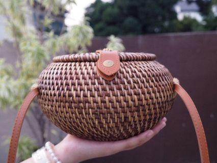 rounded rattan sling bag