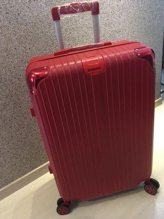 "26"" Lovely Classic Red Luggage with protection cap."