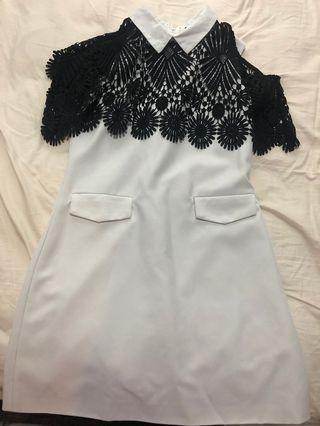 🚚 Black cape over white dress