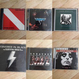 Van Halen, AC/DC, Kiss, and Alice Cooper CD albums
