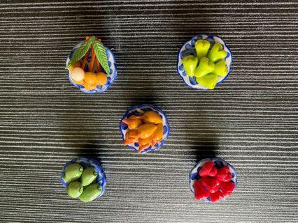 Miniature fruits in a porcelain bowl