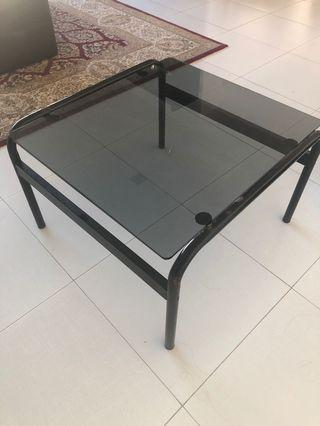 Black tinted glass side table