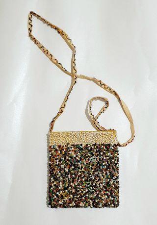 Beaded sling bag