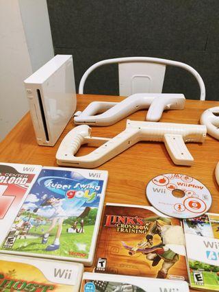 Nintendo Wii working with 8 original games, 2 guns, wiimote
