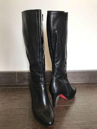 Soft black leather boots