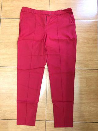 Celana bahan merah ada motif garis size XL