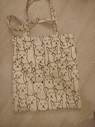 Angry cat faces tote bag